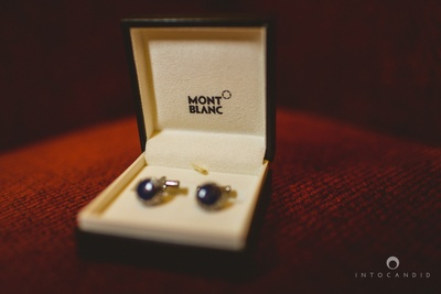 Mont Blanc blue cuff links to match the bride's reception outfit