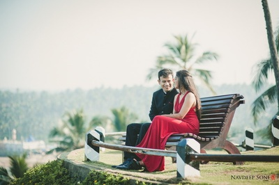 Black royal jodhpuri suits with oxidized button detailing and red pocket square for the pre wedding photo shoot