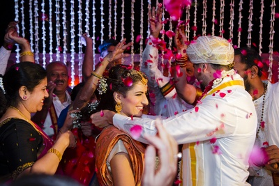 Family and friends shower the couple with flower petals during the jaimala function!