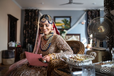 Ain is seen smiling as she reads a letter written by a loved one.