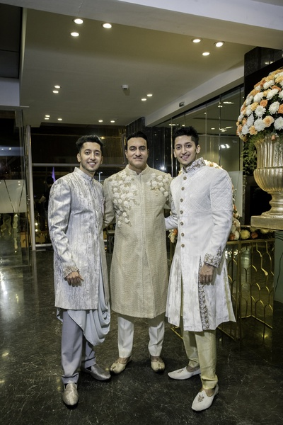 Azhar with his brother and father.