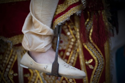 The grooms ivory jootis embelished with beads and crystals