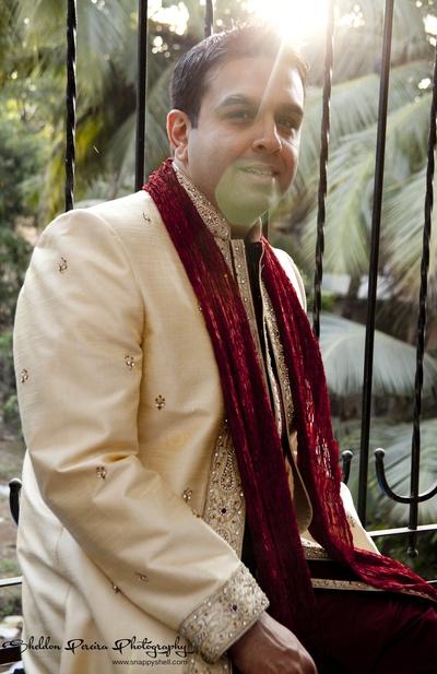 Cream silk textured Sherwani styled with a crushed dupatta