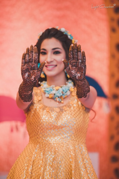 Paris shows off her mehndi design for her hands at the mehndi function at The Imperial Hotel, New Delhi