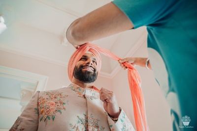 Groom getting ready for the wedding ceremony in a Sabyasachi suit