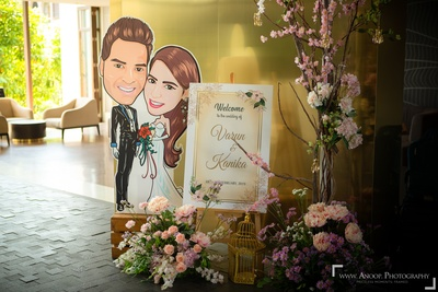 The couple's caricature signage for the welcome lunch.