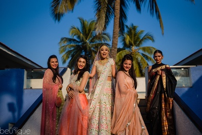 the bride with her bridesmaids on her wedding day