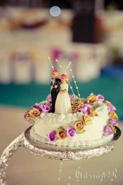 Wedding cake with flower decoration and classic cake topper