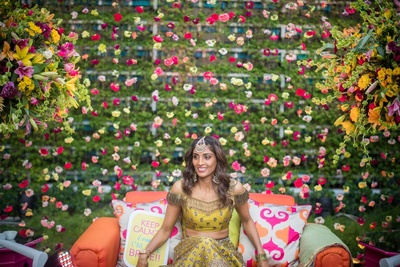 bride in her mehendi outfit for the mehndi ceremony