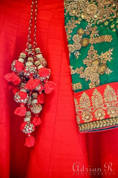 Blouse embellished with gold zari work and sequins. Lehenga embellishment ideas for the bride