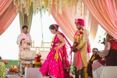 The couple taking pheras during their wedding ceremony.