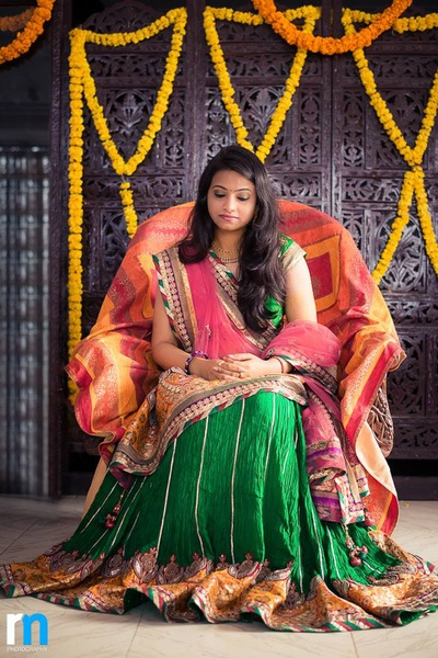 Forest green and blush pink lehenga embellished with gota patti, floral embroidery and thread work