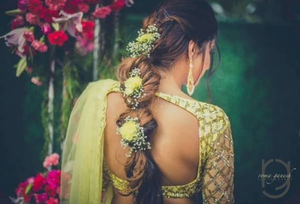 - Twisted fishtail braid with yellow roses: