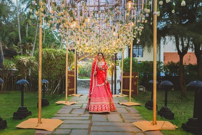 the resplendent bride in a red Sabyasachi lehenga for her wedding