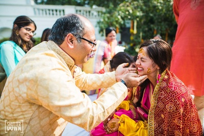 Candid moment between father and daughter captured by ShutterDown Photography