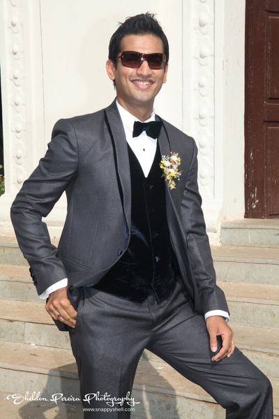 Grey textured wedding suit styled with a velvet waistcoat and matching bow tie