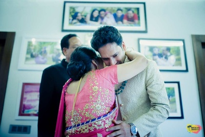 Emotional moment captured between the groom and his mother