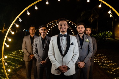 the groom with his groomsmen at the engagement ceremony