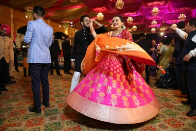 the couple dancing at their sangeet ceremony