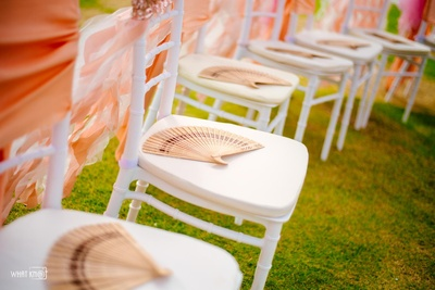Chair decoration idea with japanese fans casually placed on each one!