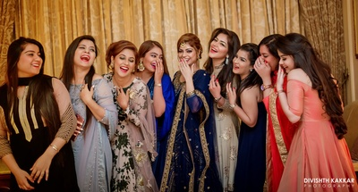 Pretty bridesmaids and their pretty smiles shot brilliantly by Divishth Kakkar Photography.