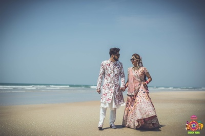 the bride and groom at the beach for the wedding shoot