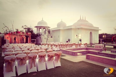 Vedi mandap setup, seating arrangement with gold tisse tie backs for the outdoor destination wedding ceremony