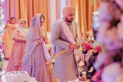 The bride and groom taking pheras at their sikh wedding.