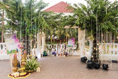 With brass elemnts, flower petals, candles, cascading bells and colourful signages, the entrance to the Bhajan Sandhya is gorgeous!