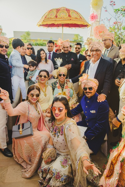 Baarat poses in a group photo before entering the wedding venue