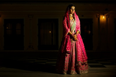 The bride in a bright pink lehenga