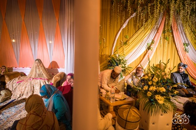 In a traditional Kashmiri Muslim wedding, the bride and groom sit in separate quarter, divided by a veil.