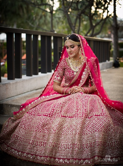 Pink and silver bridal lehenga for the bride's wedding day