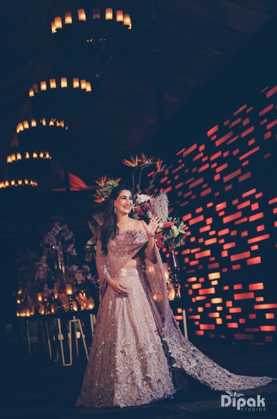 bride in a gorgeous off-shoulder lehenga for the cocktail party