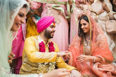 A candid capture of the bride and groom at a pre wedding function