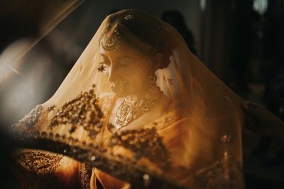 A beautiful veil shot of the bride prior to her wedding ceremony.