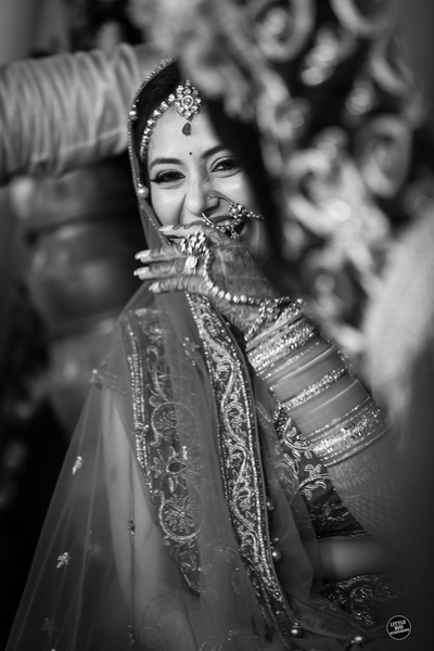 Smiling out of joy on her big day.