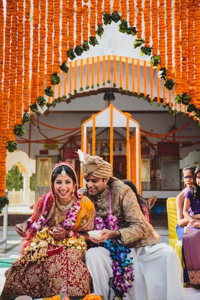 Fun wedding ceremony held at Karneshwar Temple decorated beautifully with genda phool.