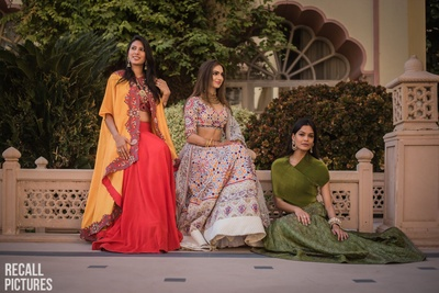 Brides and bridesmaids posing at the mehendi ceremony