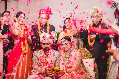 The family showers the newlyweds with flower petals!