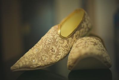 Customized jhootis with embroidery and embellishments for the groom
