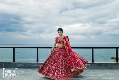 the bride twirling in her radiant red lehenga