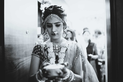Black and white photograph of the bride performing pre wedding functions