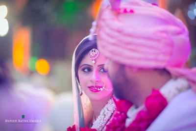 Hooped maang tikka studded with stones, nath and radiant bridal makeup