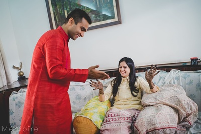 Bride and groom showing each other their mehendi