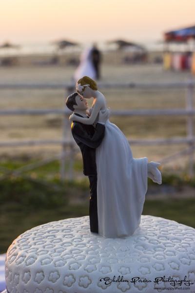 White fondant wedding cake with topper