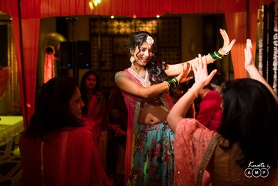 Bride dancing with her bridesmaids during the  sangeet ceremony at Novotel, Goa