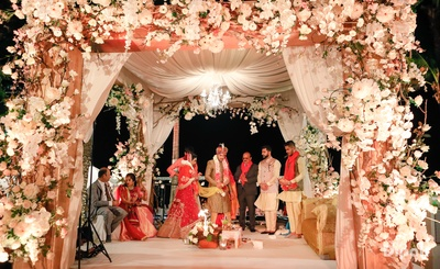 The bride and groom take pheras as part of the wedding ceremony