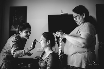 Black and white fun moments captured while bride is getting ready.