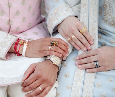 the beautiful customised rings worn by both the grooms